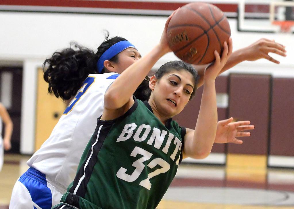 . Bonita\'s Kandyce Smith (32) rebounds against Bishop Amat in the first half of the Covina basketball tournament at Covina High School in Covina, Calif., on Saturday, Dec. 14, 2013. Bonita won 49-41.   (Keith Birmingham Pasadena Star-News)