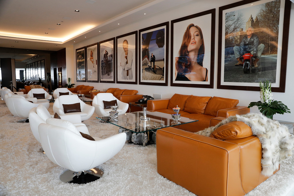. This Thursday, Jan. 26, 2017, photo shows a lounge area decorated with photographs of celebrities at a $250 million mansion in the Bel-Air area of Los Angeles. The mansion, the most expensive home listed in the U.S., includes 12 bedroom suites, 21 bathrooms, five bars, three gourmet kitchens, a spa and an 85-foot infinity swimming pool with stunning views of Los Angeles. (AP Photo/Jae C. Hong)