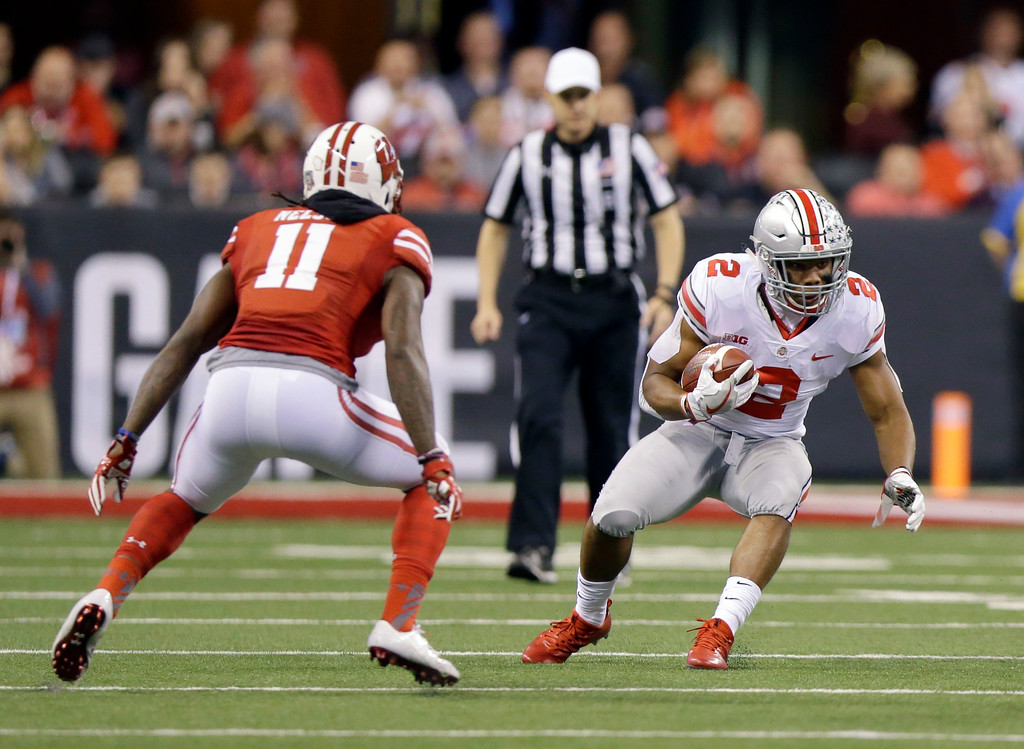 . Ohio State running back J.K. Dobbins, right, runs with the ball as Wisconsin cornerback Nick Nelson defends during the first half of the Big Ten championship NCAA college football game, Saturday, Dec. 2, 2017, in Indianapolis. (AP Photo/Michael Conroy)