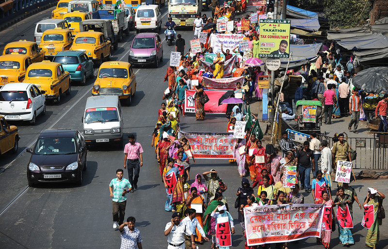 . Indian female labourers and sex workers participate in a rally on International World Women\'s day  in Kolkata on March 8, 2013. The demonstrators participated in the rally to demand equal social and finacial rights and securitys.  DIBYANGSHU SARKAR/AFP/Getty Images