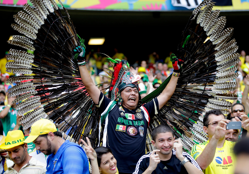 . A Mexican fan shows off his costume before the group A World Cup soccer match between Brazil and Mexico at the Arena Castelao in Fortaleza, Brazil, Tuesday, June 17, 2014. (AP Photo/Andre Penner)