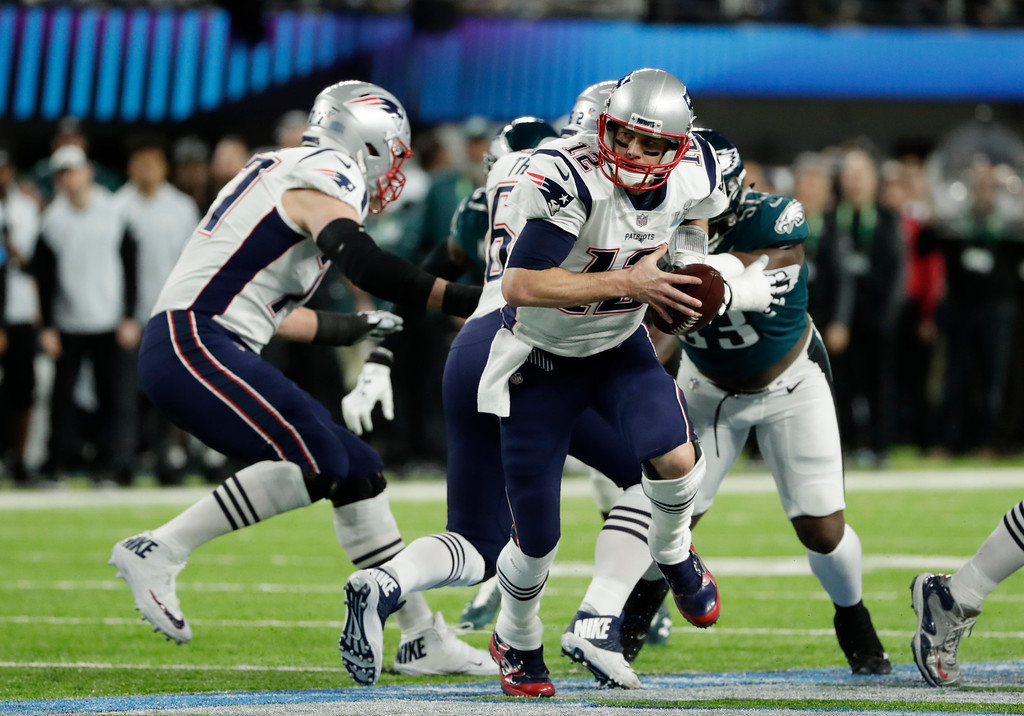 . New England Patriots quarterback Tom Brady (12) looks to pass, during the first half of the NFL Super Bowl 52 football game, Sunday, Feb. 4, 2018, in Minneapolis. (AP Photo/Frank Franklin II)