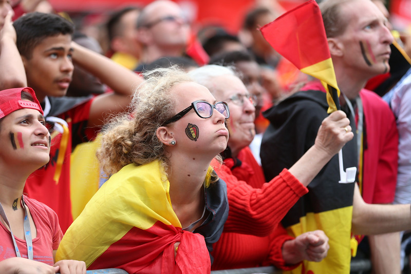 . Red Devils\' supporter react as they watch the 2014 FIFA World Cup quarter final football match between Belgium and Argentina on a big screen near King Baudouin Stadium in Brussels on July 5, 2014. (AFP PHOTO / BELGA / NICOLAS MAETERLINCK)