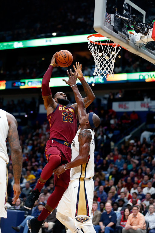 . Cleveland Cavaliers forward LeBron James (23) goes to the basket against New Orleans Pelicans forward Dante Cunningham in the first half of an NBA basketball game in New Orleans, Saturday, Oct. 28, 2017. (AP Photo/Gerald Herbert)