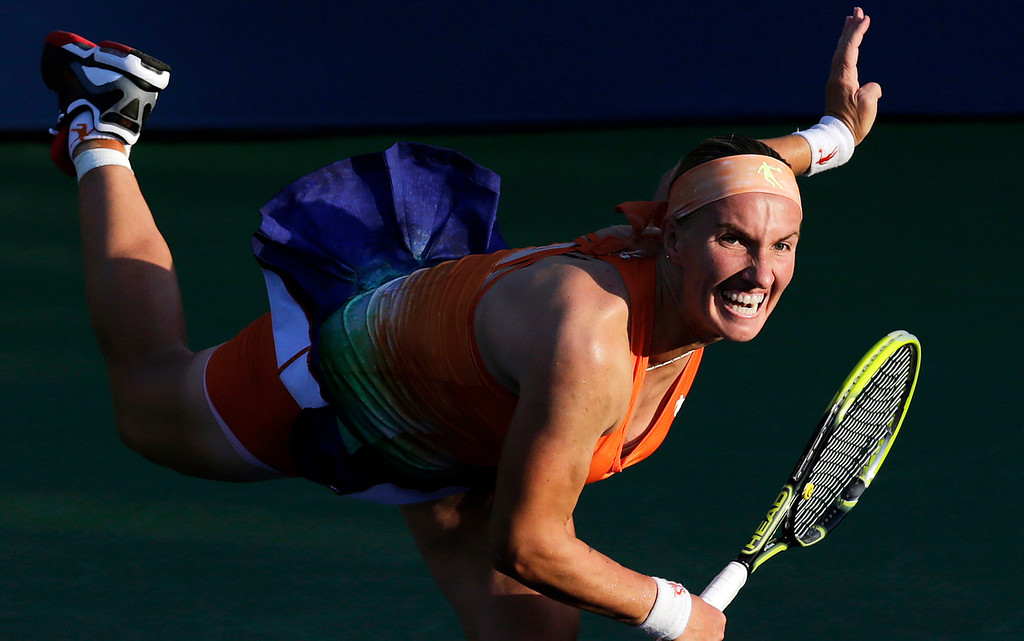 . Svetlana Kuznetsova, of Russia, follow through with a serve against Mallory Burdettte, of the United States, during the first round of the 2013 U.S. Open tennis tournament, Tuesday, Aug. 27, 2013, in New York. (AP Photo/Charles Krupa)