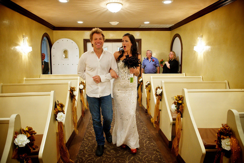 . October 2, 2013 - Jon Bon Jovi walks Branka Delic down the aisle before her wedding to Gonzalo Cladera at the Graceland Wedding Chapel in Las Vegas, NV on October 12, 2013. The bride started on online petition to have Mr. Bon Jovi walk her down the aisle at the same chapel where he was married to his wife in 1989. The rock superstar surprised her on the wedding day before playing a show with his band at the MGM Grand Garden Arena.  (Photo credit: David Bergman / Bon Jovi)