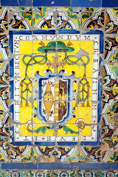 Ecclesiastical badge on old glazed ceramic tiles, Fine Arts Museum, Seville, Spain