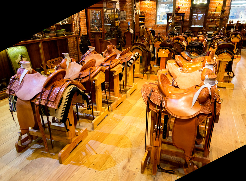 Saddles in Hamley's saddlery.  The ones in front cost over $5000.