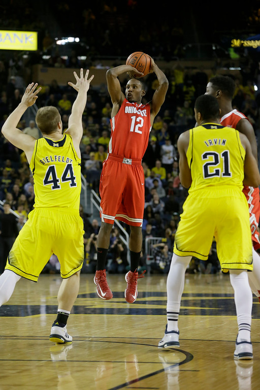 . Ohio State forward Sam Thompson shoots over Michigan forward Max Bielfeldt (44) during the second half of an NCAA college basketball game, Sunday, Feb. 22, 2015 in Ann Arbor, Mich. Michigan defeated Ohio State 64-57. (AP Photo/Carlos Osorio)