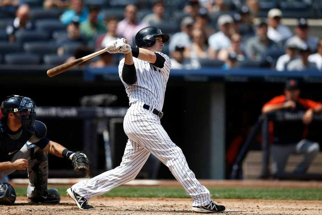 . New York Yankees\' Stephen Drew hits a fourth-inning, ground-rule, RBI double off Detroit Tigers starting pitcher Rick Porcello, scoring the Yankees\' Carlos Beltran, in a baseball game at Yankee Stadium in New York, Thursday, Aug. 7, 2014.  (AP Photo/Kathy Willens)