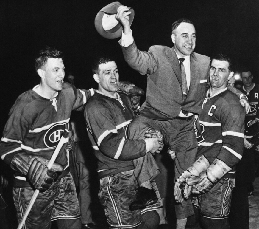 . Montreal Canadian\'s players hoist their coach into the air after winning the Stanley Cup for the second year in succession in Montreal, Quebec on April 17, 1957. Left to right: Dickie Moore, left wing; Bernie Geoffrion, right wing; coach Hector �Toe� Blake; and Rocket Richard. (AP Photo)