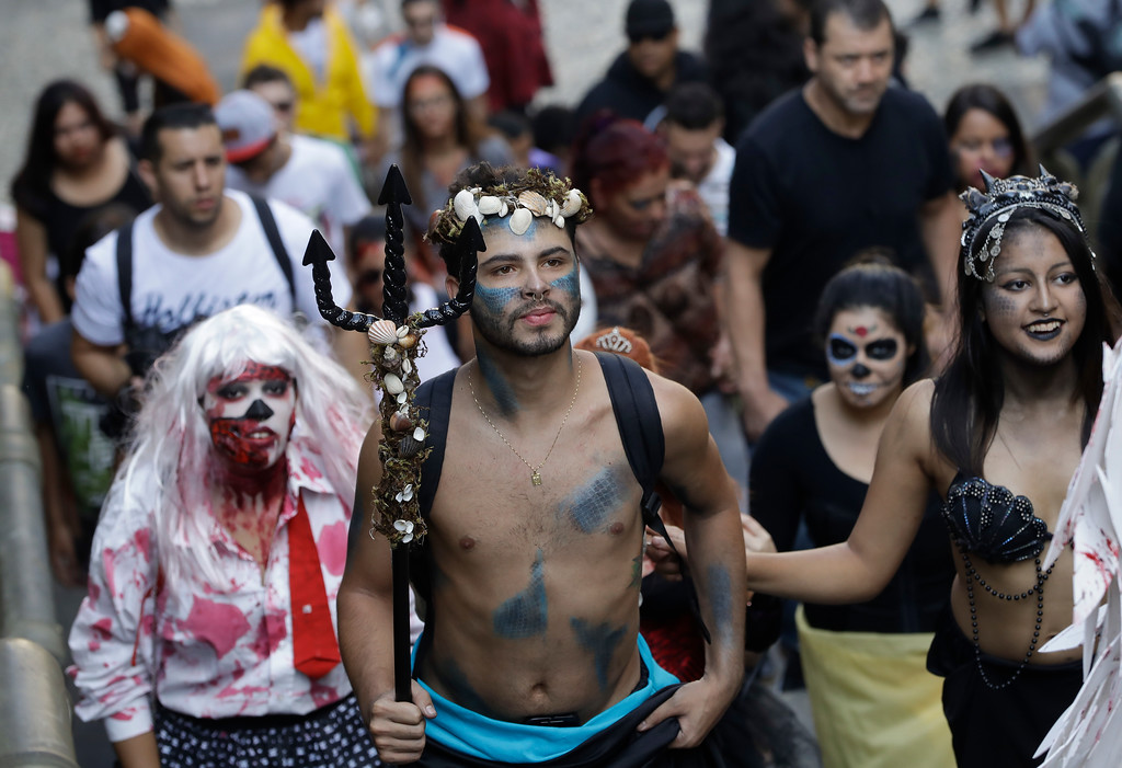 . Participants in zombie costumes take part in the Zombie Walk in Sao Paulo, Brazil, Thursday, Nov. 2, 2017. Participants commemorated the Day of the Dead with the annual Zombie Walk. (AP Photo/Andre Penner)