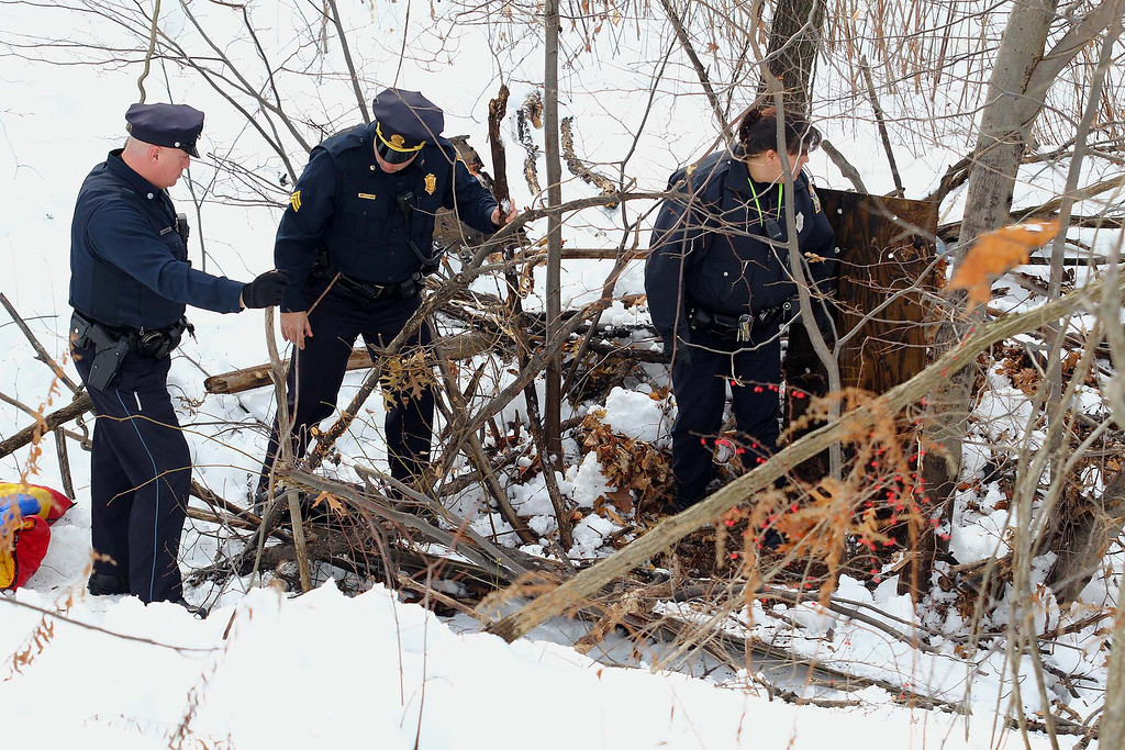 . Fitchburg Police officers search and area near the Nashua River that searchers thought was of interset and they ruled it out during the search for Jeremiah Oliver, 5, the missing Fitchburg boy on Saturday. SENTINEL & ENTERPRISE/JOHN LOVE