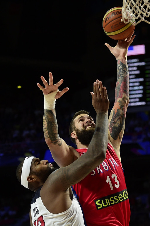 . Serbia\'s centre Miroslav Raduljica (R) vies with US centre DeMarcus Cousins during the 2014 FIBA World basketball championships final match USA vs Serbia at the Palacio de los Deportes in Madrid on September 14, 2014.   JAVIER SORIANO/AFP/Getty Images