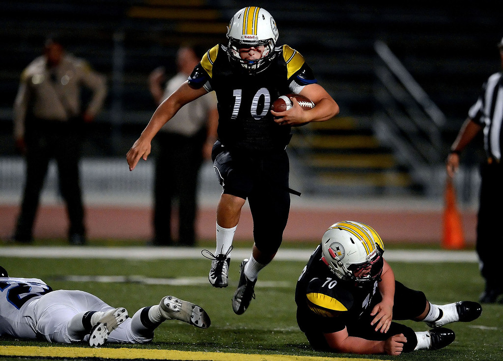 . Bassett quarterback Nicolas Colmenero (10) runs for a first down against Duarte in the first half of a prep football game at Bassett High School in La Puente, Calif., on Friday, Nov. 1, 2013.    (Keith Birmingham Pasadena Star-News)