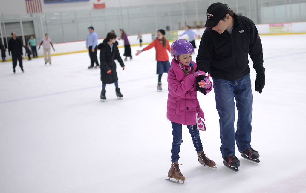 . CENTENNIAL, CO. DECEMBER 25: People enjoy ice skating at South Suburban Sports Center in Centennial, Colorado on December 25, 2013. For the fourteenth year, the Denver Community Kollel Women\'s Division is offering a Jewish Family Extravaganza of family fun and entertainment.  (Photo by Hyoung Chang/The Denver Post)
