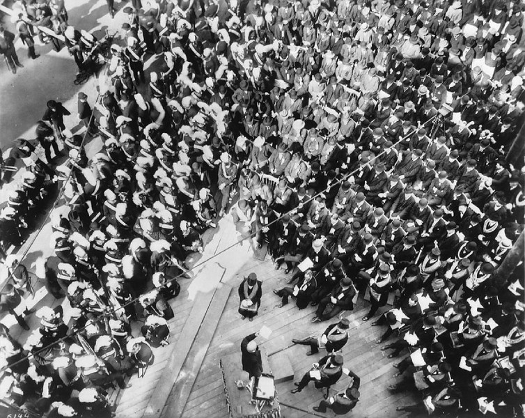 View looking down on a ceremony for the laying of the corner stone of the Chamber of Commerce building, March 28, 1903