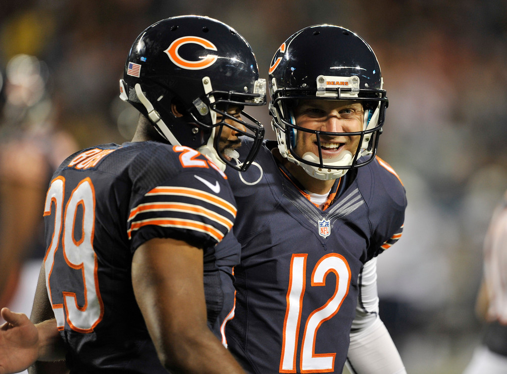 . Chicago Bears running back Michael Bush (29) celebrates his touchdown run with quarterback Josh McCown (12) during the second half of the preseason NFL football game against the San Diego Chargers, Thursday, Aug. 15, 2013, in Chicago. (AP Photo/Jim Prisching)