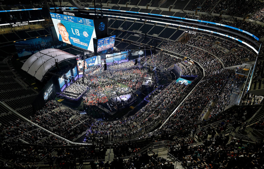 . Boise State\'s Leighton Vander Esch is seen on the video screen after the Dallas Cowboys selected him during the first round of the NFL football draft, Thursday, April 26, 2018, in Arlington, Texas. (AP Photo/David J. Phillip)
