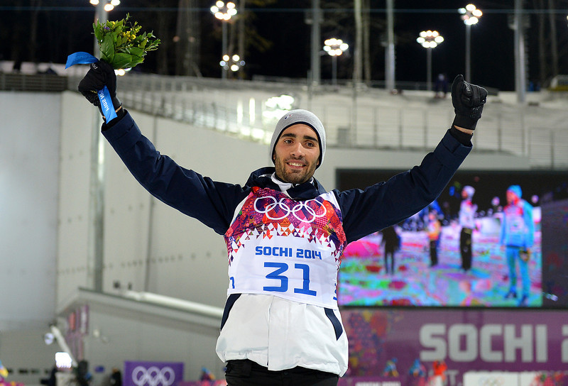 . Gold medalist Martin Fourcade of France celebrates on the podium during the flower ceremony for the Men\'s Individual 20 km during day six of the Sochi 2014 Winter Olympics at Laura Cross-country Ski & Biathlon Center on February 13, 2014 in Sochi, Russia.  (Photo by Harry How/Getty Images)