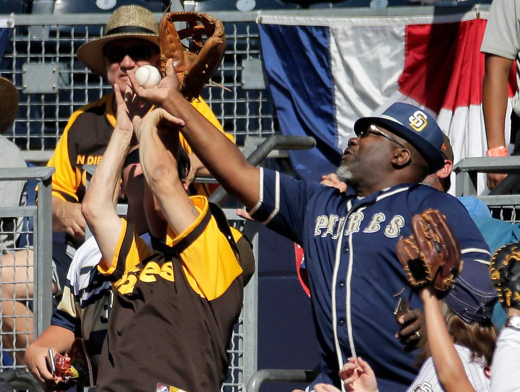 . Fans reach for a foul ball during the first inning of the All-Star Futures baseball game between the U.S. Team and the World Team, Sunday, July 10, 2016, in San Diego. (AP Photo/Matt York)