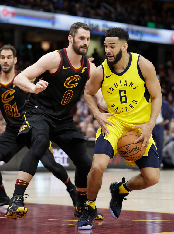 . Indiana Pacers\' Cory Joseph (6) drives past Cleveland Cavaliers\' Kevin Love (0) in the second half of Game 5 of an NBA basketball first-round playoff series, Wednesday, April 25, 2018, in Cleveland. The Cavaliers won 98-95. (AP Photo/Tony Dejak)