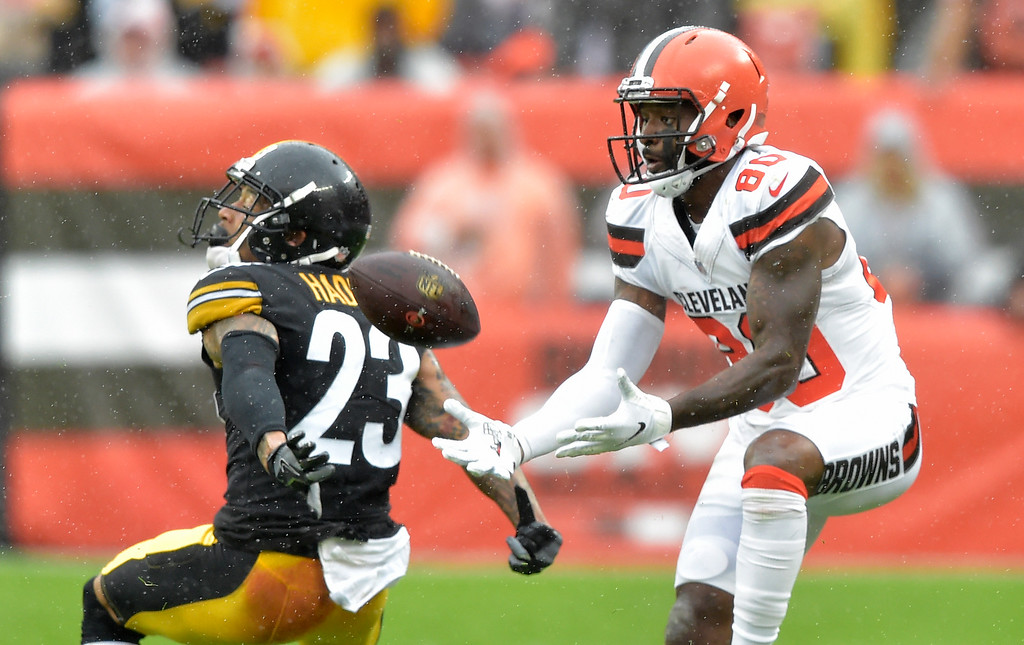 . Cleveland Browns wide receiver Jarvis Landry (80) catches a pass for a first down in front of Pittsburgh Steelers defensive back Joe Haden (23) during the first half of an NFL football game, Sunday, Sept. 9, 2018, in Cleveland. (AP Photo/David Richard)