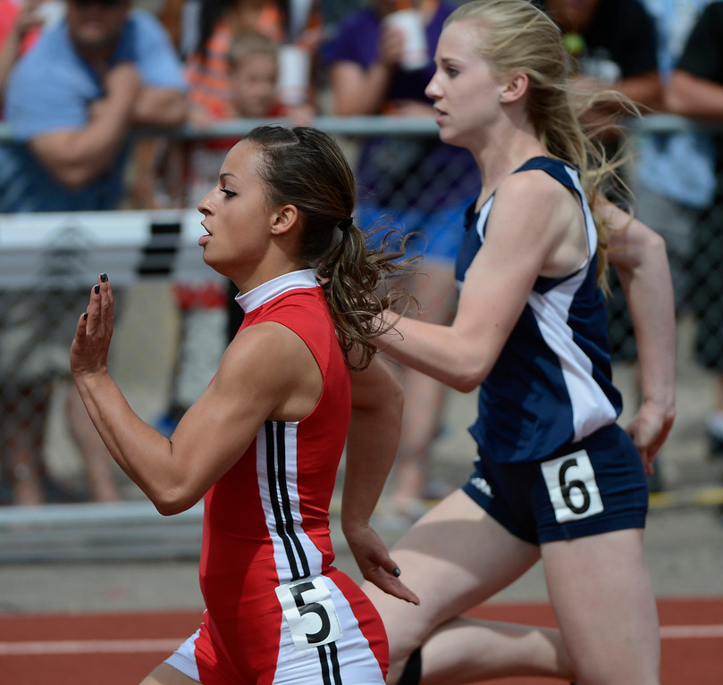 . LAKEWOOD, CO - MAY 18:  Ashton Rinker, left, La Veta High School, edges out Taylor Alexander, Vail Christian High School, to win the girls 1A 100 meter dash final at the Colorado State Track and Field Championships at Jeffco Stadium, Saturday morning, May 18, 2013.  (Photo By Andy Cross/The Denver Post)