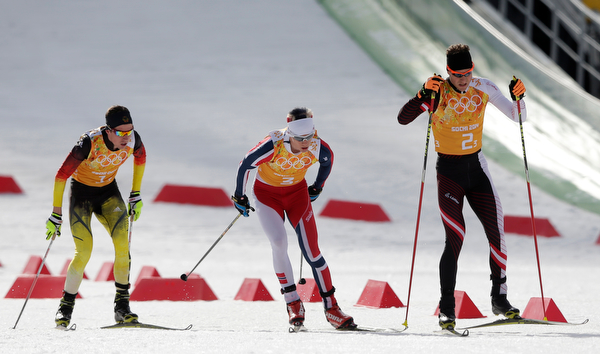 . Germany\'s Johannes Rydzek, Norway\'s Magnus Krog and Austria\'s Bernhard Gruber, from left, compete during the cross-country portion of the Nordic combined Gundersen large hill team competition at the 2014 Winter Olympics, Thursday, Feb. 20, 2014, in Krasnaya Polyana, Russia. (AP Photo/Matthias Schrader)