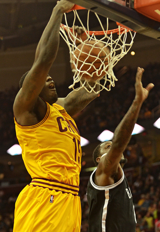 . Michael Allen Blair/Digital First Media Cavs\' forward Anthony Bennett dunk over Nets\' defefender Andray Blatche during the first quarter of Wednesday\'s game at Quicken Loans Arena. Big questions remain with Bennett heading into his second year after being selected number one overall in last year\'s NBA draft.
