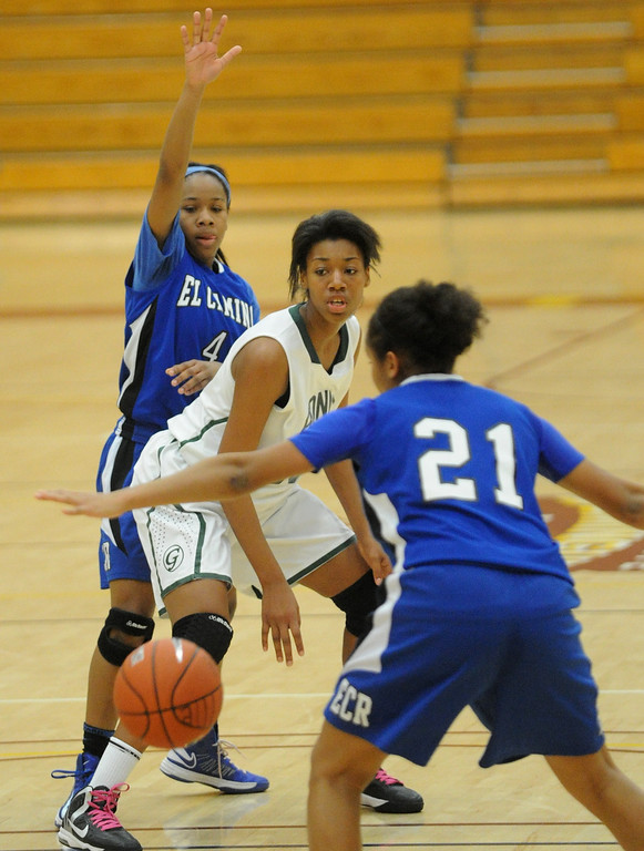. 02-23-2012--(LANG Staff Photo by Sean Hiller)- Narbonne beat El Camino Real 47-39 in Saturday\'s L.A. City Section Division I semifinal girls basketball game. El Camino\'s Sukari Richardson (4) and Delaney Thomas (21) guard Narbonne\'s TyBriann Jones (15).