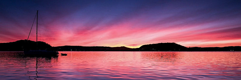 Pink colored cirrostratus cloud, sunset seascape.