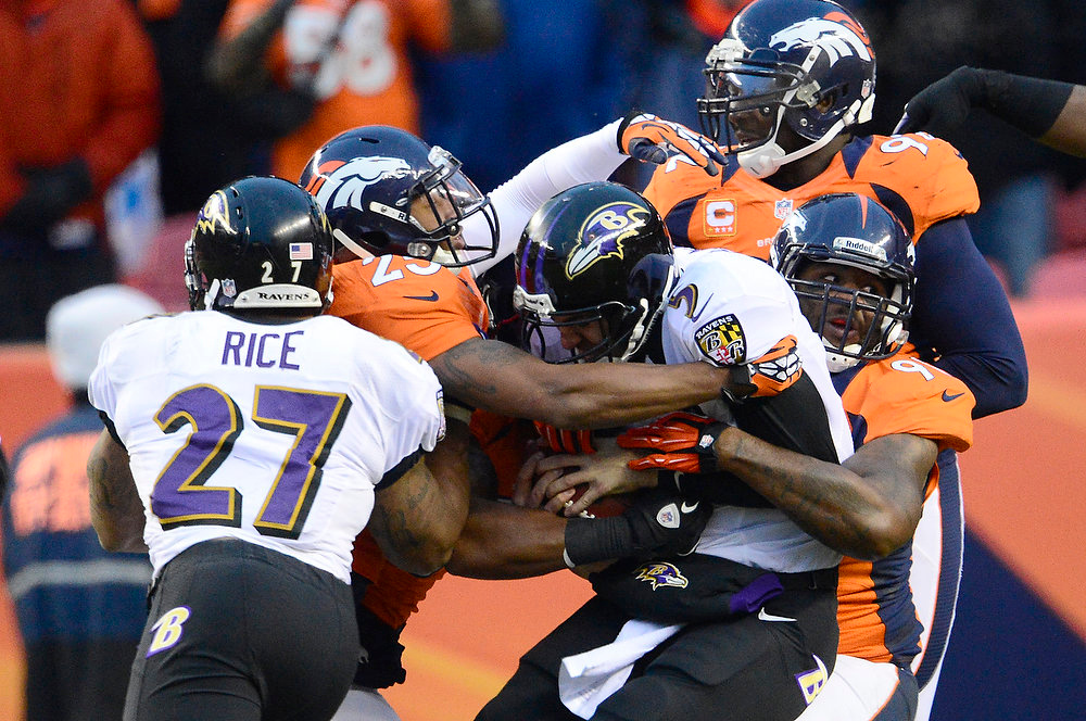 Description of . Baltimore Ravens quarterback Joe Flacco (5) is sacked in the third quarter for a loss of 8 yards. The Denver Broncos vs Baltimore Ravens AFC Divisional playoff game at Sports Authority Field Saturday January 12, 2013. (Photo by AAron  Ontiveroz,/The Denver Post)