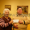 Dromintee GFC held a Charity Football match in Aid of Learning Difficulties in Adults & Children, Martin Morgan presents a Cheque for £500 to Lily Mc Caul (vice chairperson gateway club), 06W48N58