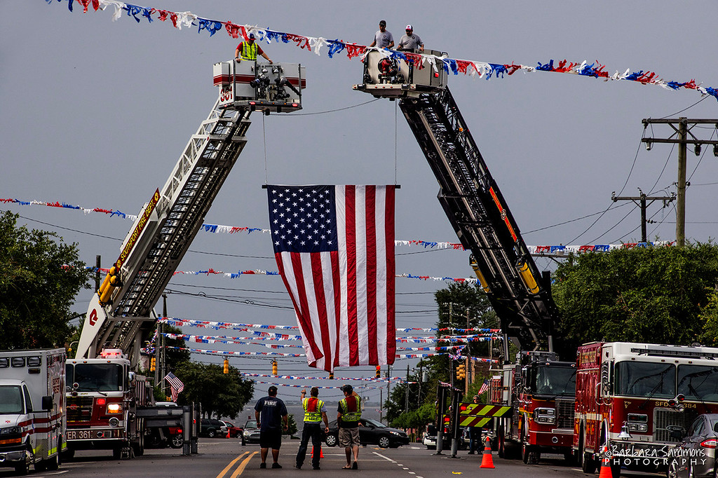 Firefighters Demonstration - Flag over Howe Street; July 1, 2017