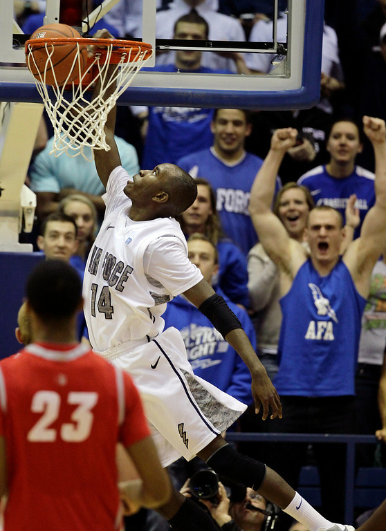 . Air Force\'s Michael Lyons scores during the second half of an NCAA college basketball game against New Mexico, at the Air Force Academy, in Colorado, Saturday, March 9, 2013. (AP Photo/Brennan Linsley)