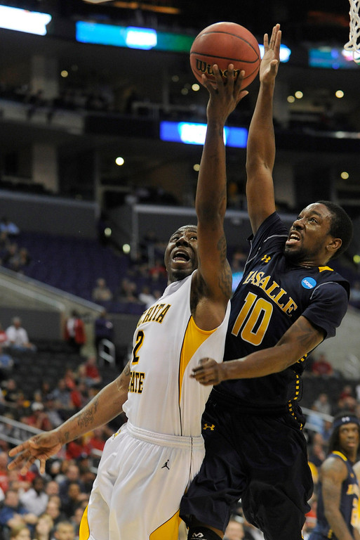 . Wichita #2 Malcolm Armstead goes to the hoop against La Salle #10 Sam Mills. Wichita State defeated La Salle 72-58 at Staples Center for the West Regional of the NCAA Division I Men\'s Basketball Championships. Los Angeles,CA 3/28/2013(John McCoy/Staff Photographer