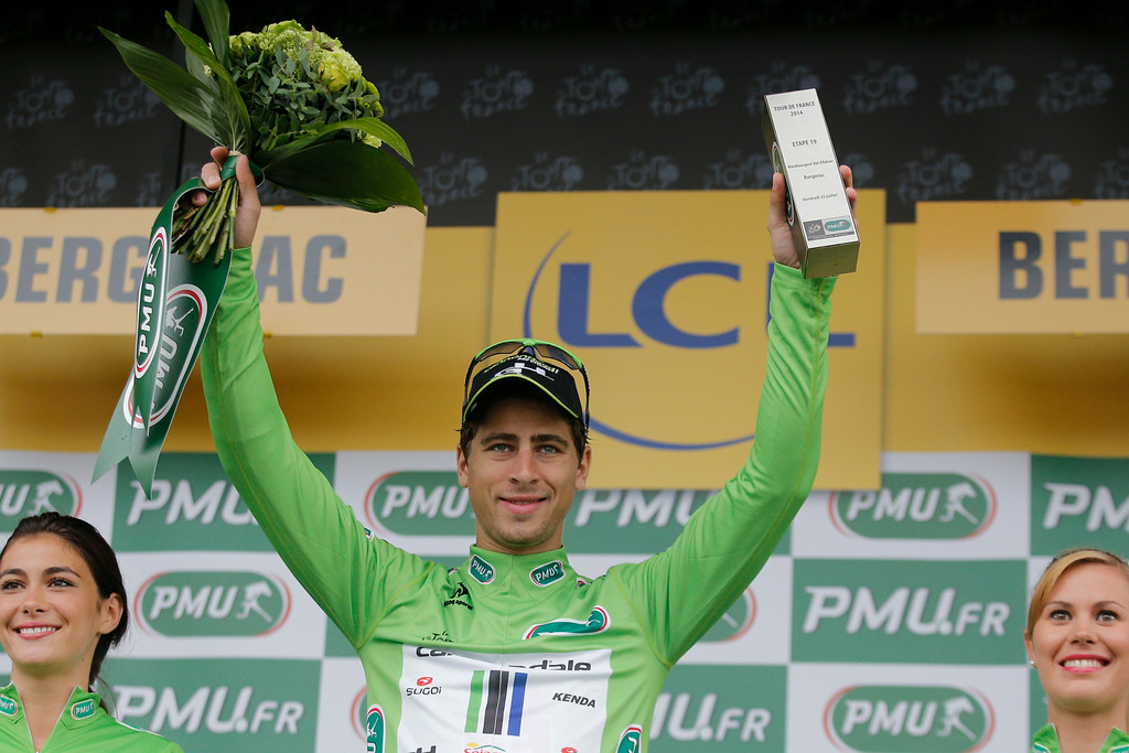 . Peter Sagan of Slovakia, wearing the best sprinter\'s green jersey, celebrates on the podium of the nineteenth stage of the Tour de France cycling race over 208.5 kilometers (129.6 miles) with start in Maubourguet and finish in Bergerac, France, Friday, July 25, 2014. (AP Photo/Christophe Ena)