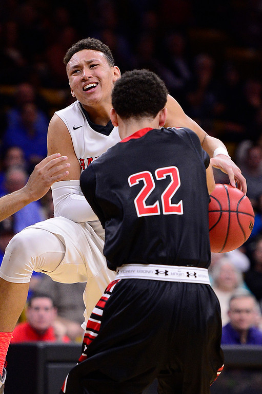 . Colbey Ross (1) of Eaglecrest gets the ball stolen while going up for a shot by Marquis Kraemer (22) of Rangeview during the third quarter at the Coors Events Center on March 11, 2016 in Boulder, Colorado. Eaglecrest defeated Rangeview 58-55 to advance to the 5A finals of the Colorado state high school basketball tournament.  (Photo by Brent Lewis/The Denver Post)