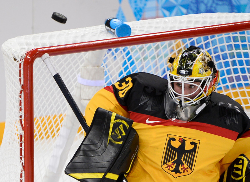 . Germany\'s goalkeeper Jennifer Harss makes a save during the Women\'s Ice Hockey Group B match Germany vs Sweden at the Shayba Arena during the Sochi Winter Olympics on February 11, 2014.  (JONATHAN NACKSTRAND/AFP/Getty Images)