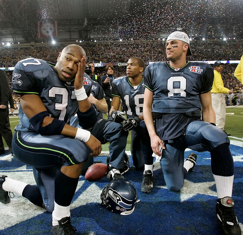 . SEATTLE SEAHAWKS - Seattle Seahawks players Shaun Alexander (37), D.J. Hackett (18) and Matt Hasselbeck look on after losing 21-10 to the Pittsburgh Steelers in the Super Bowl XL football game on Sunday, Feb. 5, 2006, in Detroit. (AP Photo/Elaine Thompson)