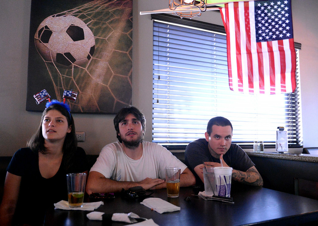 . From left, Isabella Bossatnoli, 29, Renzo Garberoglio, 28, and Chris Smith, 29, all of Redlands, watch the USA vs Belgium world cup game during a viewing party on Tuesday, July 1, 2014 at Darby\'s American Cantina in Redlands, Ca. (Photo by Micah Escamilla/The Sun)