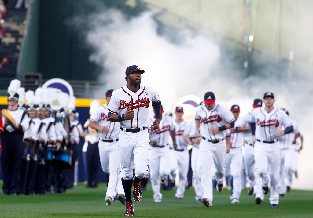 . Atlanta Braves outfielder Jason Heyward (L), leads the Atlanta Braves team onto the field during their opening day ceremonies prior to their MLB National League baseball game against the Philadelphia Phillies at Turner Field in Atlanta, Georgia  April 1, 2013.   REUTERS/Tami Chappell