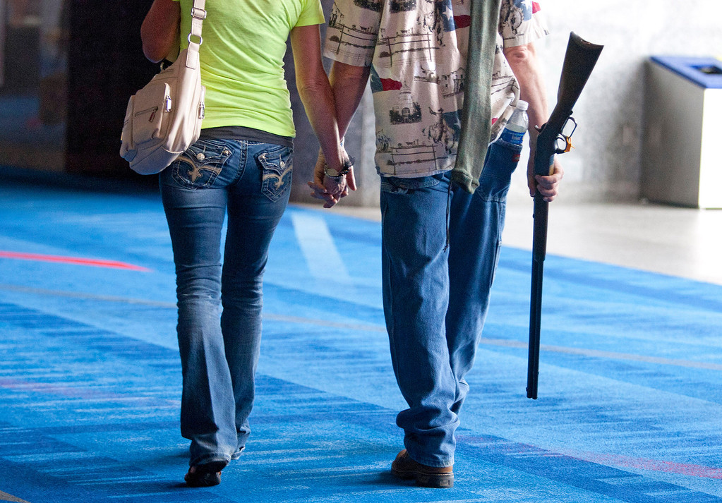 . CORRECTS TO SAY RIFLE NOT SHOTGUN - Barry Bailey and his wife Judy, of DeRidder La., walk out hand-in-hand, after having their 1873 Winchester rifle appraised at the NRA\'s Antiques Guns and Gold Showcase during the National Rifle Association\'s 142 Annual Meetings and Exhibits at the George R. Brown Convention Center Thursday, May 2, 2013, in Houston. NRA\'s Antiques Guns and Gold Showcase is a television show that runs on the Sportsman Channel. The 2013 NRA Annual Meetings and Exhibits runs from Friday, May 3, through Sunday, May 5.  More than 70,000 are expected to attend the event with more than 500 exhibitors represented. The convention will features training and education demos, the Antiques Guns and Gold Showcase, book signings, speakers including Glenn Beck, Ted Nugent and Sarah Palin as well as NRA Youth Day on Sunday. (AP Photo/Houston Chronicle, Johnny Hanson)
