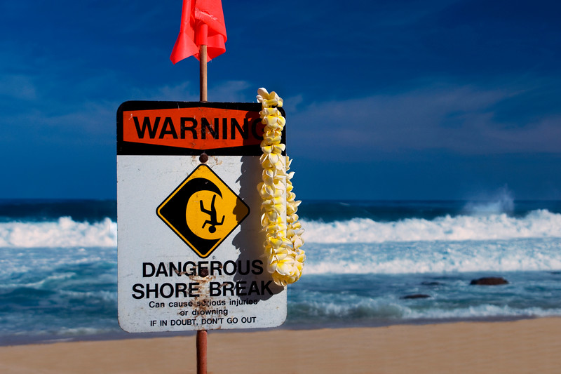 Warning sign on beach at Pipeline