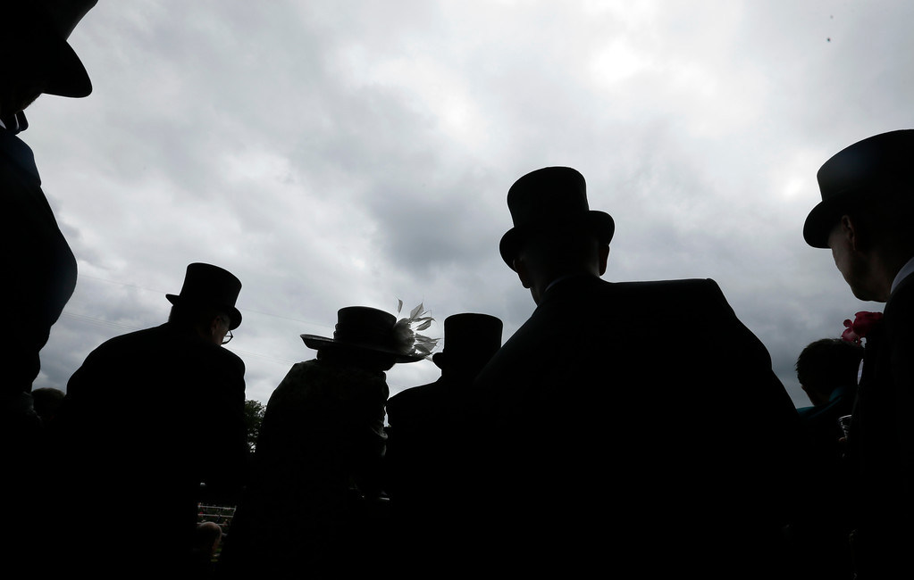 . Racegoers on the first day of the Royal Ascot horse race meeting in Ascot, England, Tuesday, June 19, 2018. (AP Photo/Tim Ireland)