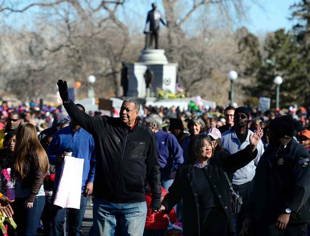 . Former Denver Mayor Wellington Webb and wife Wilma lead off the Marade from City Park. The 29th annual Martin Luther King, Jr. Marade takes place with participants gathering at the King memorial site in City Park in Denver to listen to speeches and songs honoring King. Then the crowd makes its way marching down E. Colfax Ave. to Civic Center Park where birthday cake is served to all. (Photo by Kathryn Scott Osler/The Denver Post)