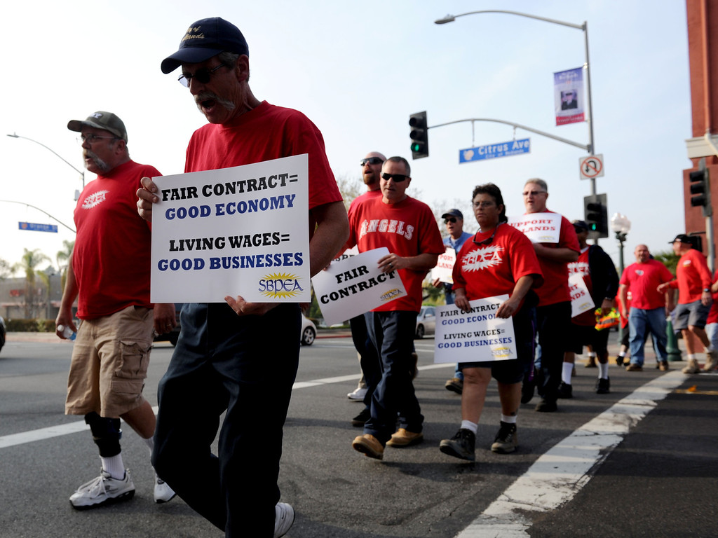 . (John Valenzuela/Staff Photographer)  Members of the General Employment Association of Redlands (G.E.A.R), demonstrate to city hall in Redlands, Tuesday, before the start of the city council meeting, March 19, 2013.
