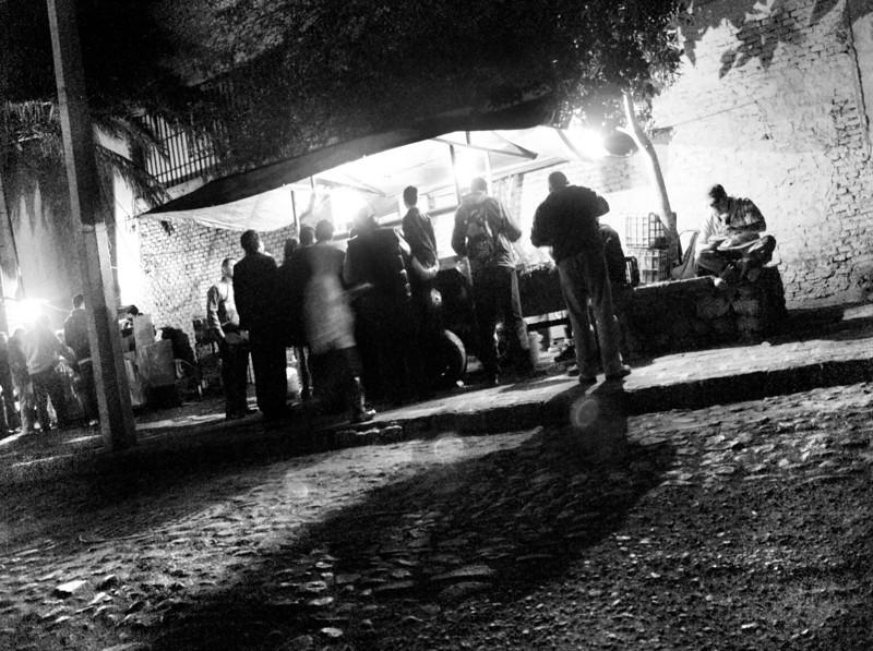 dinner on the night sidewalk bw lr.jpg