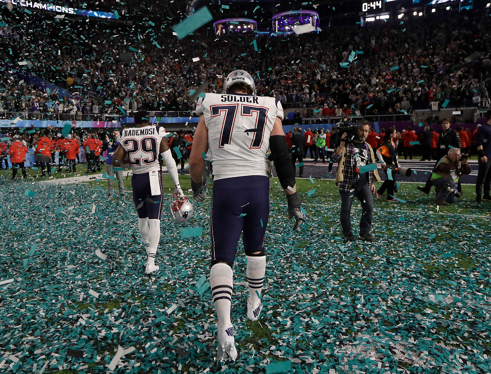 . New England Patriots\' Johnson Bademosi (29) and Nate Solder walk off the field after the NFL Super Bowl 52 football game against the Philadelphia Eagles Sunday, Feb. 4, 2018, in Minneapolis. The Eagles won 41-33. (AP Photo/Mark Humphrey)